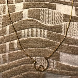 Gold necklace with part circle and heart